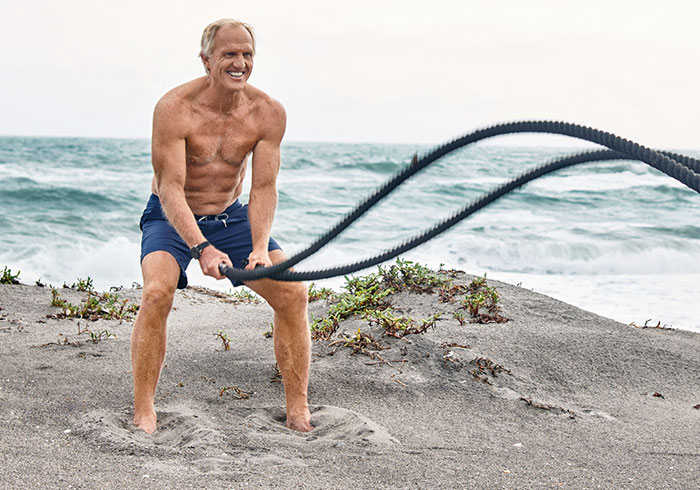 Greg Norman working out on the Beach