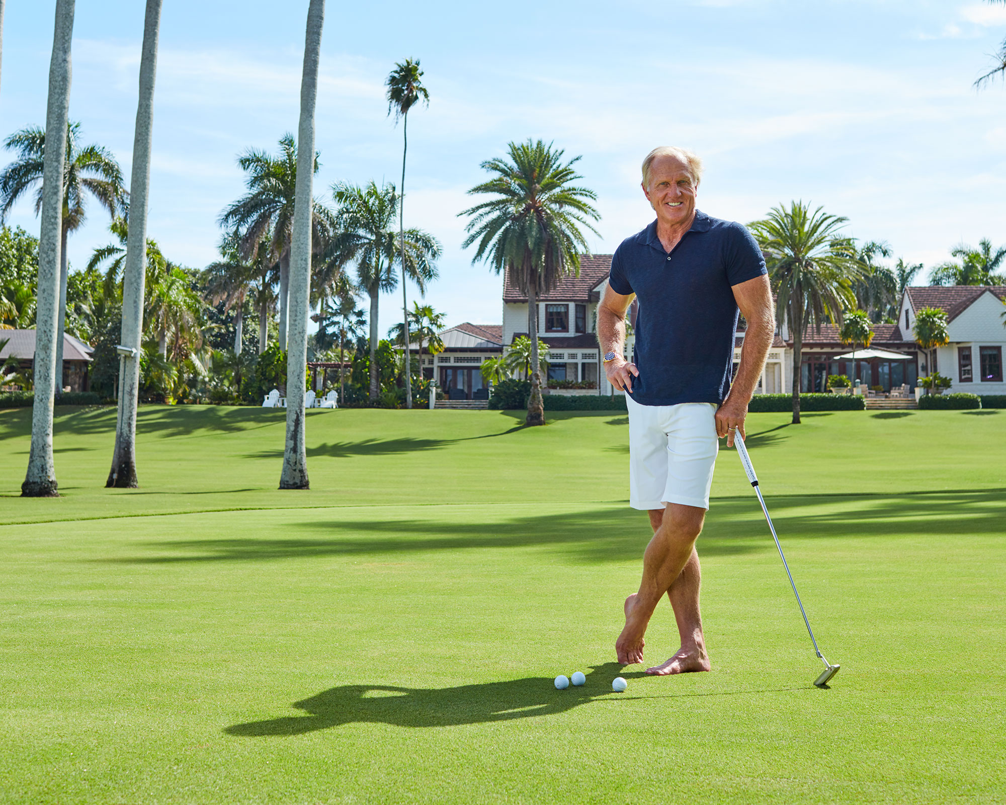Greg Norman with a putter
